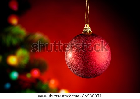 Christmas decoration against red background with Christmas-tree - stock photo