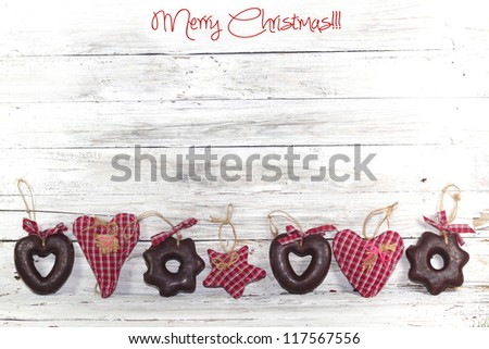 Christmas decoration and gingerbread over wooden background - stock photo