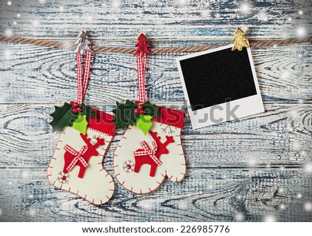 Christmas decoration and photo frame on the wall - stock photo