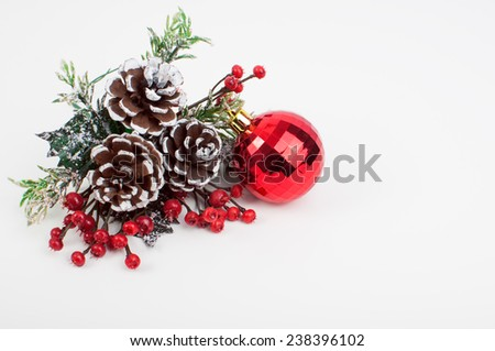 Christmas decoration and red bauble on white background - stock photo