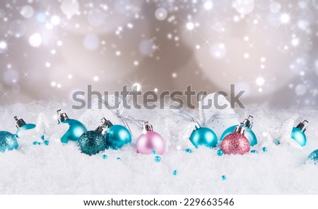 Christmas decoration, balls and textile hearts on snow with abstract background - stock photo