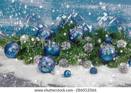 Christmas decoration. Blue Christmas decorations and silver pine cones background. Done with a vintage retro filter. Macro, selective focus  - stock photo