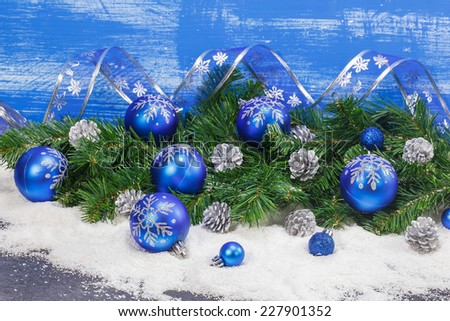 Christmas decoration.  Blue Christmas decorations and silver pine cones background. Macro, selective focus.     - stock photo