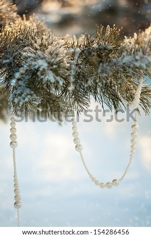 christmas decoration: Burning candle in metal flower pot with cookies and fir branches on beige background - stock photo