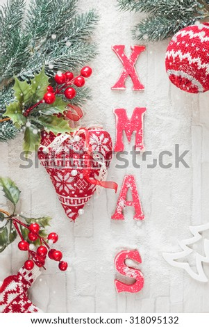 Christmas Decoration.  Christmas background with woolly  Christmas decorations and XMAS letters on rustic wood background.