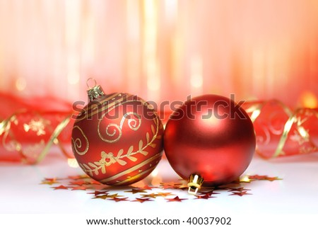 Christmas Decoration--Closeup of red christmas ball with abstract light background.