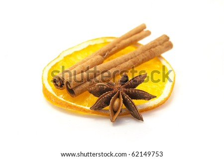 christmas decoration: dried orange with cinnamon and star anise - stock photo