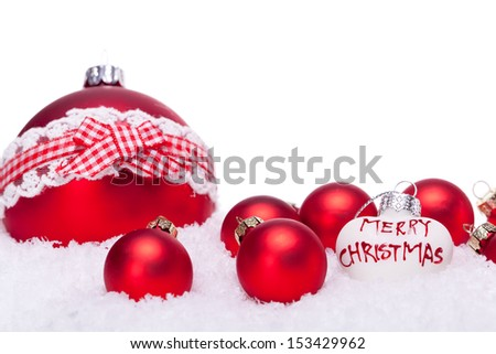 christmas decoration festive red bauble in snow isolated copy space