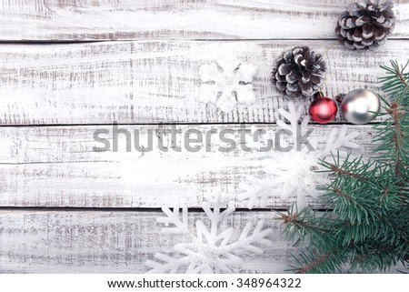 Christmas decoration frame on white rustic wooden background with copy space for text. Christmas background or greeting card. Toned image. - stock photo