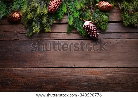 Christmas decoration frame on wooden background - stock photo
