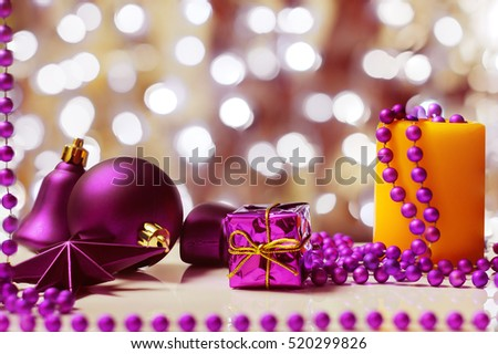 Christmas decoration from magentas Christmas toys and beads on a background with boken