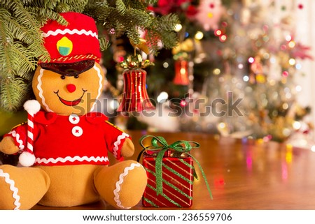 Christmas decoration; Ginger bread man dancing Christmas toy on Christmas lights bokeh background