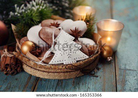 Christmas decoration, gingerbread, candles, fir on a wooden table. - stock photo