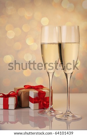 Christmas decoration glasses of champagne with red ribbon gifts - stock photo