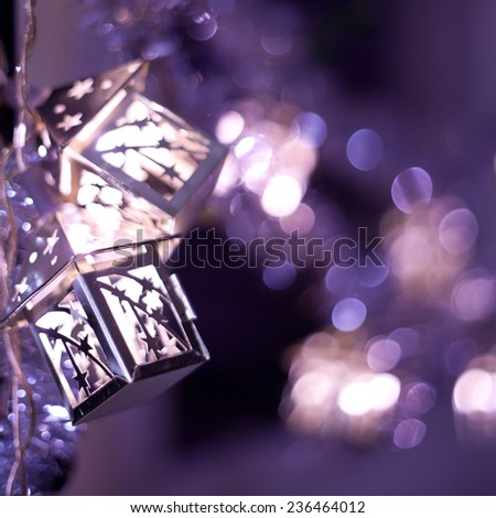 Christmas decoration- hanging lanterns with holly twigs. decorations sold during Christmas market. Nobody. Macro. Background. Christmas, winter postcard