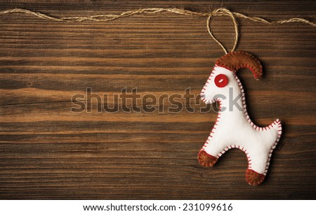 Christmas Decoration Hanging Toy, Grunge Wooden Background, New Year of the Goat, Grain Brown Wood Wall, Xmas Decorative Texture - stock photo