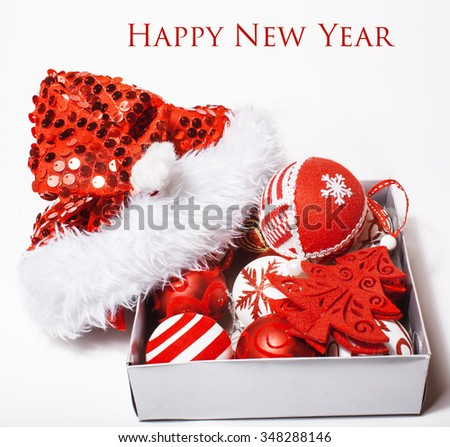 christmas decoration isolated , white background for post card greetings, toy design on tree macro, gifts under santas red hat - stock photo