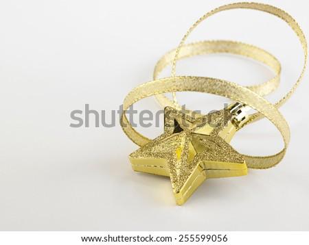 christmas decoration item star and ribbon - stock photo