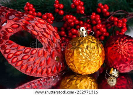 Christmas decoration mask with european holly - stock photo