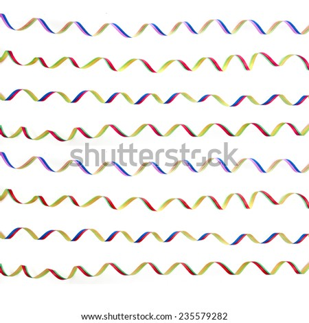 Christmas decoration of beautiful colorful streamers isolated on white - stock photo