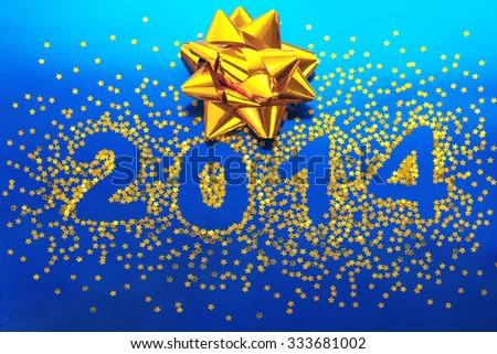 Christmas decoration of golden confetti stars  - stock photo