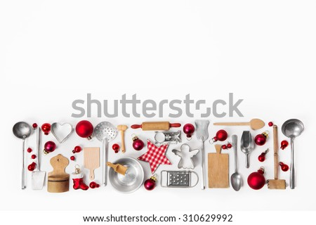 Christmas decoration of old red, white and silver cutlery and dishes. - stock photo