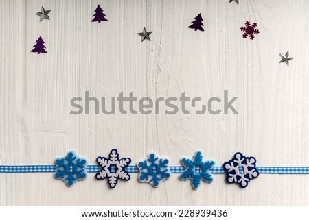 Christmas decoration on a background of white painted rustic boards with copyspace - stock photo