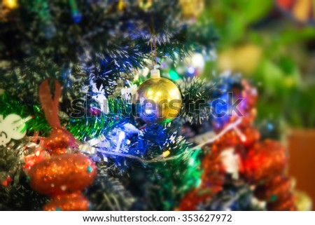 Christmas decoration on abstract background,vintage filter,soft focus - stock photo