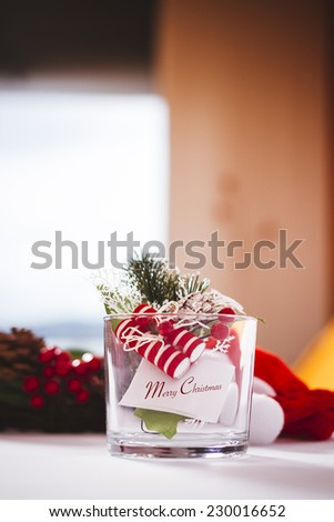 Christmas decoration on glass in interior house - stock photo