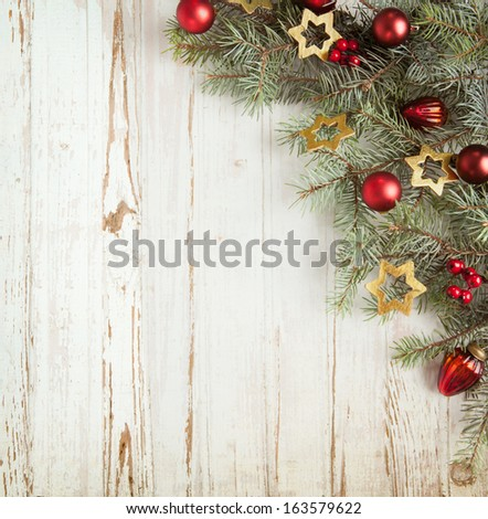 Christmas decoration on old grunge wooden board - stock photo