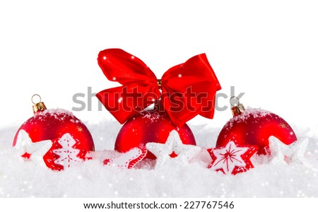 Christmas decoration on snow, Red balls isolarted on white background - stock photo