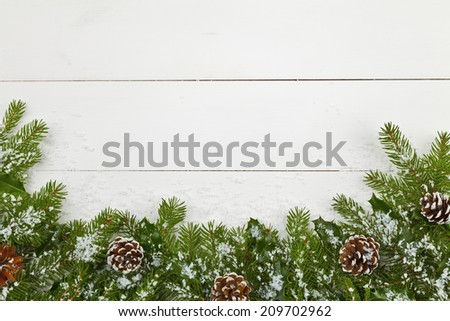 Christmas decoration on the wooden white background with snow or without - stock photo