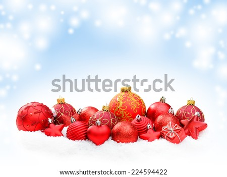 Christmas decoration on white snow, on a bokeh background - stock photo