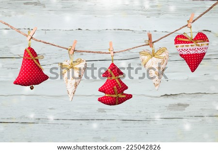Christmas decoration on wood plant with snow and snowflake - stock photo