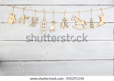 christmas decoration on wooden table -  snowflakes, angel, deer, house, tree etc. - stock photo
