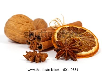 Christmas decoration: orange, anise, nuts and cinnamon;  - stock photo