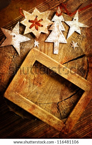 Christmas decoration over grunge  background/vintage paper christmas decoration with a sign and red ribbon - stock photo