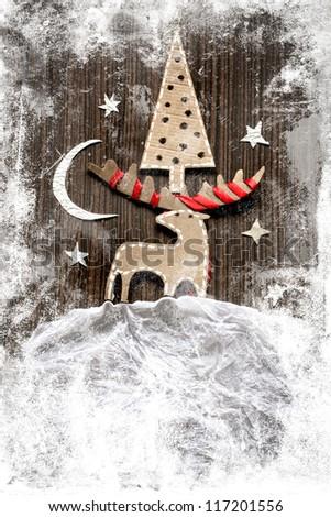 Christmas decoration over grunge background/vintage paper christmas decoration with a sign and red ribbon - stock photo