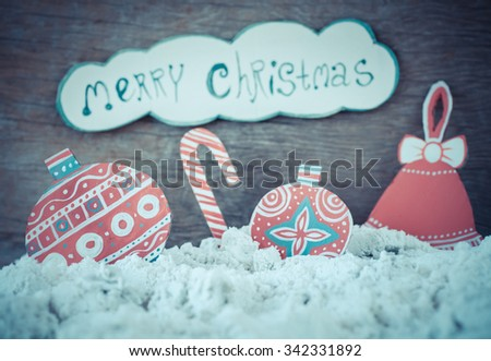Christmas decoration over grunge background/vintage paper handmade christmas balls decoration and snow on wooden background with copy space; - stock photo
