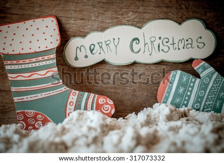 Christmas decoration over grunge background/vintage paper handmade christmas decoration and snow on wooden background with copy space; - stock photo