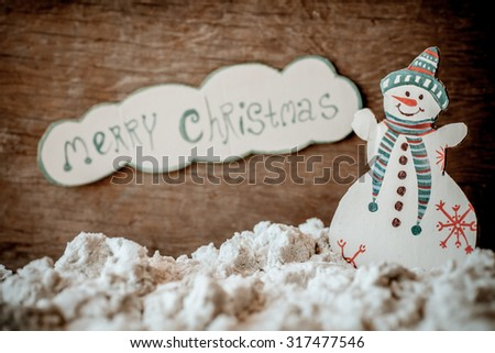 Christmas decoration over grunge background/vintage paper handmade christmas decoration and snow on wooden background with copy space.; - stock photo