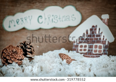 Christmas decoration over grunge background/vintage paper handmade christmas decoration and snow on wooden background with copy space - stock photo