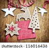 Christmas decoration over grunge wooden background/old paper bordering with christmas decoration - stock photo