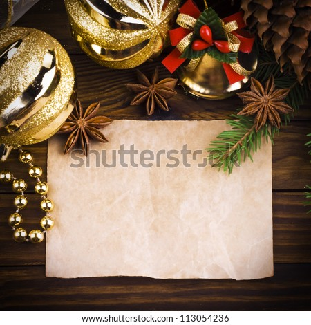 Christmas decoration over old wood background - stock photo