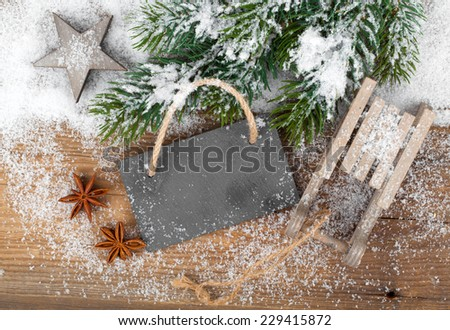 Christmas decoration over snow, wooden background - stock photo