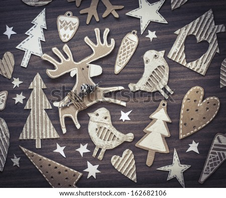 Christmas decoration over wooden  background/vintage paper christmas card - stock photo