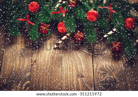 Christmas Decoration Over Wooden Background With Snow. Vintage - stock photo