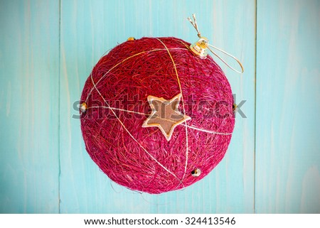 Christmas decoration red ball over wooden background on Holiday theme - stock photo