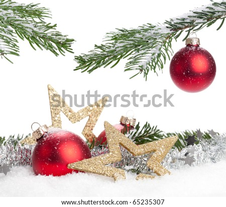 Christmas Decoration - red baubles and a branch of pine tree - stock photo