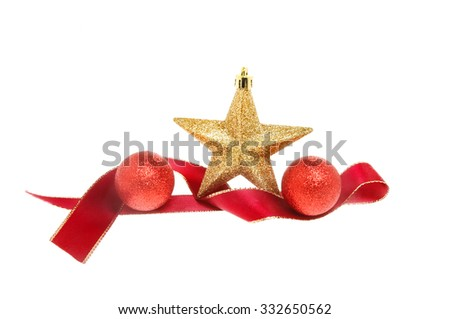 Christmas decoration, red ribbon, baubles and a gold glitter star isolated against white - stock photo